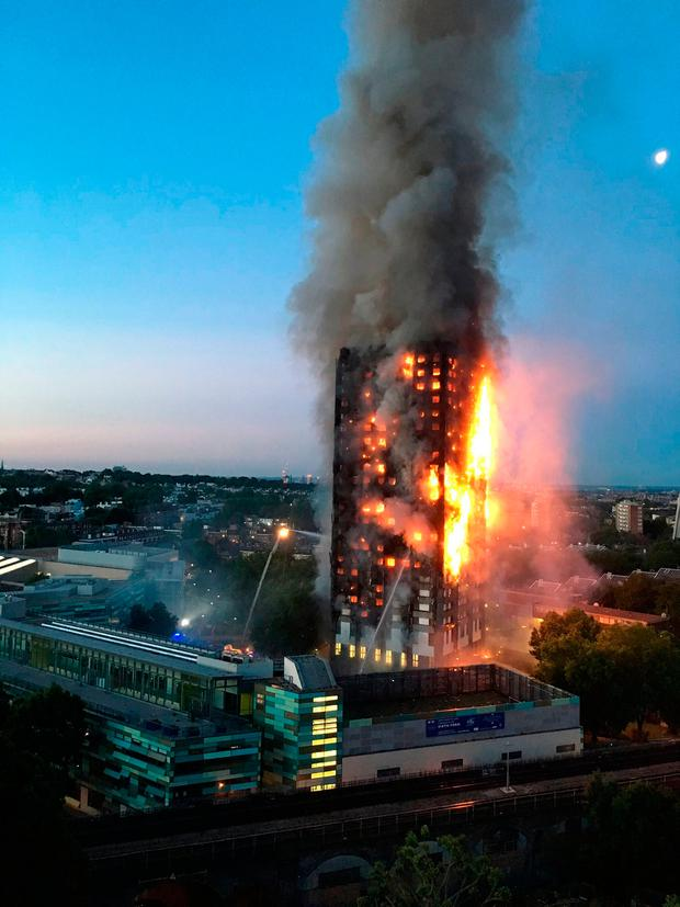 A photo taken by local resident Natalie Oxford shows flames coming from Grenfell Tower. Photo: AFP/Getty Images