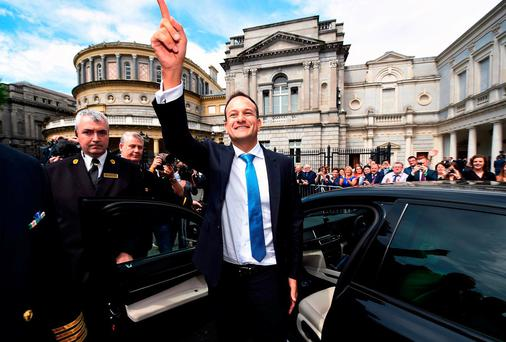 Taoiseach Leo Varadkar waves to TDs and well wishers at Leinster House yesterday. Photo: Getty