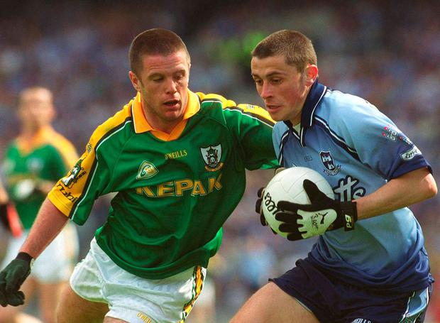 Alan Brogan is tackled by Mark O'Reilly in his first clash against Meath back in 2002. Photo: Sportsfile