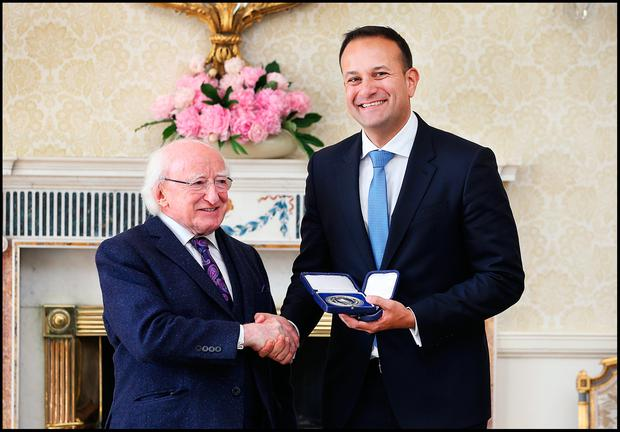 Taoiseach Leo Varadkar receives his seal of office in the State Reception Room of Aras An Uachtarain by President Michael D. Higgins. Pic Steve Humphreys