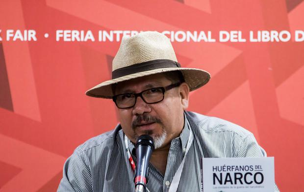 This file photo taken on November 27, 2016 shows Mexican journalist Javier Valdez speaking during the presentation of his book