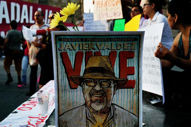 Journalists hold signs condemning violence against journalists while protesting the recent murder of the of Mexican journalist Javier Valdez on May 16, 2017 in Guadalajara. (Photo: HECTOR GUERRERO/AFP/Getty Images)