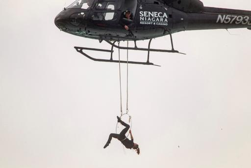 Aerialist Erendira Wallenda hangs beneath a helicopter during a stunt over the Horseshoe Falls at Niagara Falls