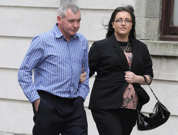 Kirsty Scally leaves the High Court in Dublin with her father James. Photo: Collins Courts