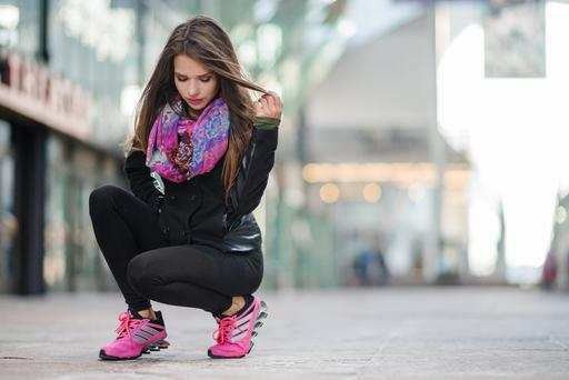 A model wearing a pair of Adidas Springblade runners