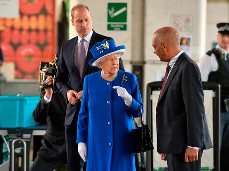 Lord Lieutenant of greater London Ken Olisa (right) greets Queen Elizabeth II and the Duke of Cambridge as they arrive to meet members of the community affected by the fire at Grenfell Tower in west London during a visit to the Westway Sports Centre which is providing temporary shelter for those who have been made homeless in the disaster. Picture: David Mirzoeff/PA Wire