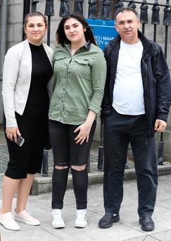 Rahel Ciurar (Center) of Church View, Dromiskin, Co. Louth pictured leaving the Four Courts with dad, Cornel (right) and her sister, Maria (Left) after a High Court action. Pic: Collins Courts