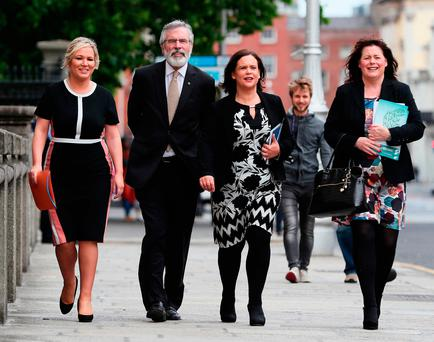 A Sinn Fein delegation led by leader Gerry Adams along with leader in the North Michelle O'Neill (left) deputy leader Mary Lou McDonald and MP Michelle Gildernew (right) arrive at Government Buildings in Dublin for a meeting with Taoiseach Leo Varadkar. Brian Lawless/PA Wire