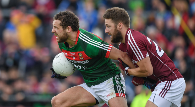 Tom Parsons of Mayo in action against Michael Lundy of Galway during the Connacht GAA Football Senior Championship Semi-Final match between Galway and Mayo at Pearse Stadium, in Salthill, Galway. Photo by Ray McManus/Sportsfile