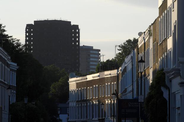 A terrace of houses is seen in front of the Grenfell Tower block that was destroyed in a fire, in north Kensington, West London, Britain June 16, 2017. REUTERS/Toby Melville