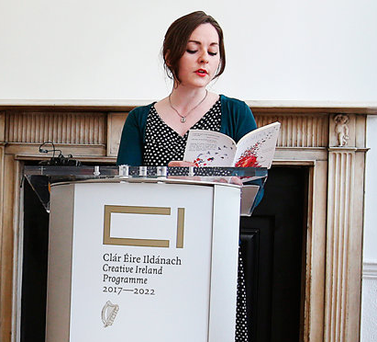 Poet Kerrie O'Brien recites from her book of poetry 'Illuminate' at Poetry Ireland's headquarters on Parnell Square Photo: Steve Humphreys