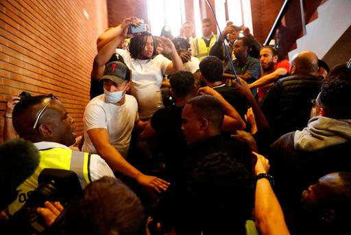 Demonstrators crowd onto a staircase as they enter Kensington Town Hall during a protest following the fire that destroyed the Grenfell Tower block Photo: REUTERS/Stefan Wermuth