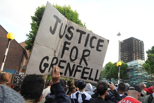 Protesters march towards The Grenfell Tower block that was destroyed by fire, in north Kensington, West London, Britain June 16, 2017. REUTERS/Toby Melville