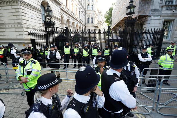 Police officers block the entrance to Downing Street during a march through Westminster, following the fire that destroyed The Grenfell Tower block, in north Kensington, West London, Britain June 16, 2017. REUTERS/Peter Nicholls