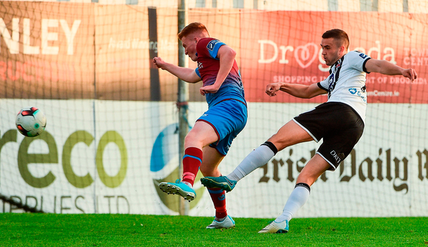 Dundalk's Michael Duffy beats Drogheda's Stephen Dunne. Photo: David Maher/Sportsfile
