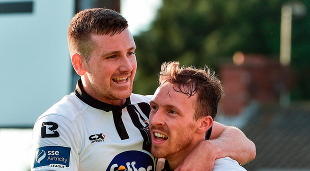 David McMillan, right, of Dundalk celebrates after scoring his side's first goal with teammate Patrick McEleney. Photo: David Maher/Sportsfile