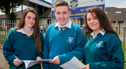 Junior Cert students at Coláiste Dún Iascaigh, Cahir, Co Tipperary, Roisin Whelan, Max Zimmann and Chloe Enright with their German paper Photo: John D Kelly
