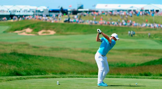 Rory McIlroy plays his shot from the first tee during the second round of the 2017 US Open at Erin Hills. Photo: Getty Images