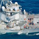 The Arleigh Burke-class guided-missile destroyer USS Fitzgerald, damaged by colliding with a Philippine-flagged merchant vessel, is seen off Shimoda, Japan in this photo taken by Kyodo June 17, 2017.