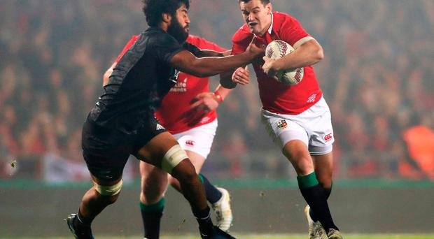 Johnny Sexton of the Lions is challenged by Akira Ioane of the Maori All Blacks