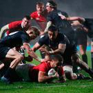 Taulupe Faletau of the Lions is hauled down short of the tryline