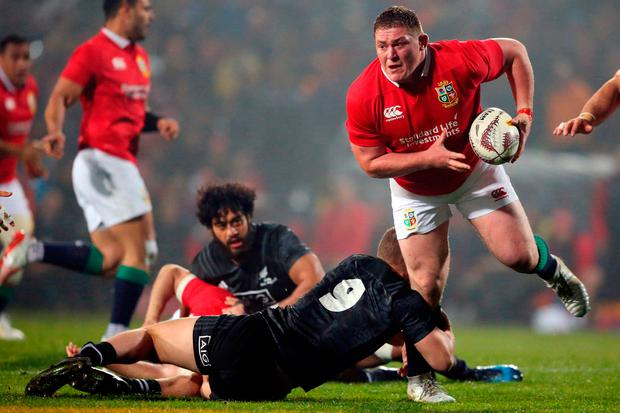 Tadhg Furlong of the British and Irish Lions (R) is tackled by New Zealand's Tawera Kerr-Barlow