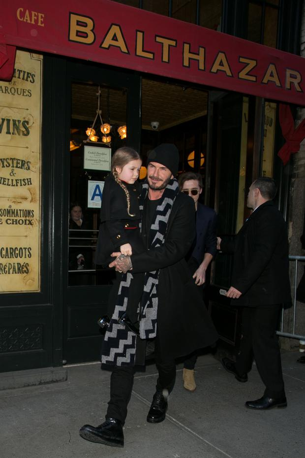 Harper Seven Beckham and David Beckham leave the 'Balthazar' restaurant on February 14, 2016 in New York City. (Photo by Marc Piasecki/GC Images)