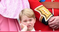 Prince George of Cambridge looks on from the balcony ahead of the annual Trooping The Colour parade at the Mall on June 17, 2017 in London, England. (Photo by Karwai Tang/WireImage)