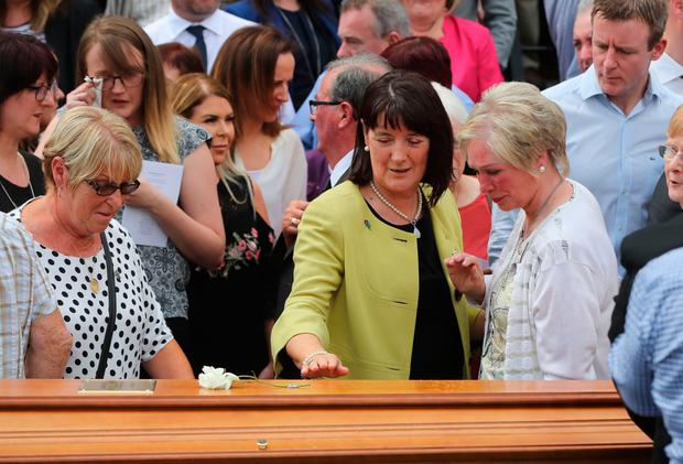 Seamus Ruddy's Sister Anne Morgan (centre) is comforted during his funeral at St Catherine's Dominican Chapel in Newry