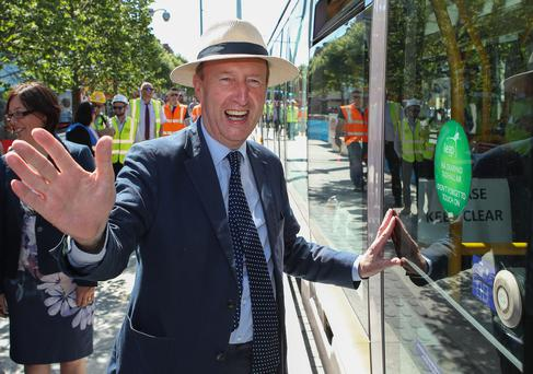 IN FOCUS: Minister for Transport Shane Ross opens the door of the first tram to run on the Luas Cross City tram test at O'Connell St, Dublin, yesterday. Picture: Maxwells
