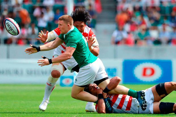 Ireland's Andrew Conway (C) is tackled by Japan's players. Photo: Getty