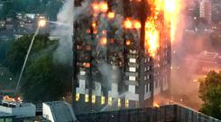 WAKING TO A NIGHTMARE: Fire-fighters' attempts to damp down the blaze were to no effect as the flames engulfed Grenfell Tower in west London. Photo: Rick Finder/PA