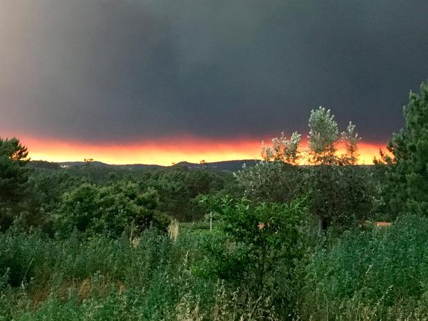 Smoke rises from a forest fire, seen from the village of Mourisco in central Portugal,