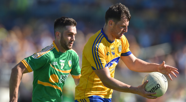 Diarmuid Murtagh of Roscommon in action against Noel Plunkett of Leitrim during the Connacht GAA Football Senior Championship Semi-Final match between Roscommon and Leitrim at Dr Hyde Park in Roscommon. Photo by David Maher/Sportsfile