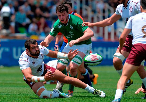 Lasha Jaiani of Georgia offloads the ball under pressure. Photo by Mark Runnacles/Getty Images