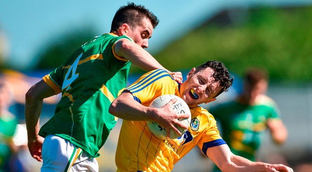 Roscommon's Ciaran Murtagh tries to slip away from the attention of Leitrim's Paddy Maguire Photo: David Maher/Sportsfile