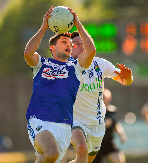 Ambrose Doran of Laois battles for control of the ball with Wicklow's Peadar Traynor Photo: Ray McManus/Sportsfile