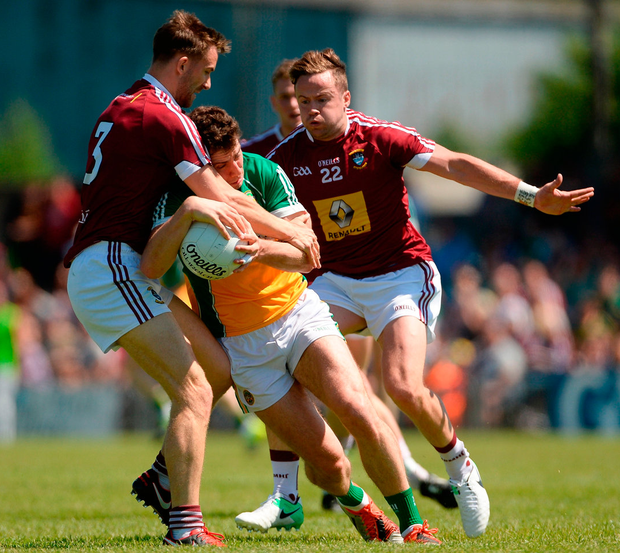 Offaly's Niall McNamee in action against Kevin Maguire (left) and Alan Gaughan of Westmeath Photo: Piaras Ó Mídheach/Sportsfile