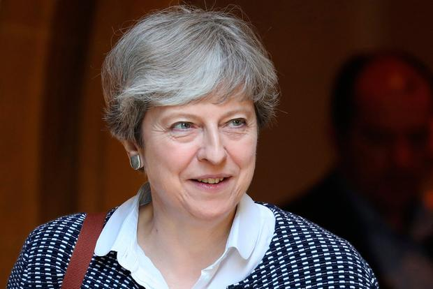 Theresa May's political career will surely be abridged by this tragedy. Photo: REUTERS/Kevin Coombs
