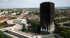 The burnt out remains of the Grenfell apartment tower are seen in North Kensington, London. Photo: REUTERS/Neil Hall