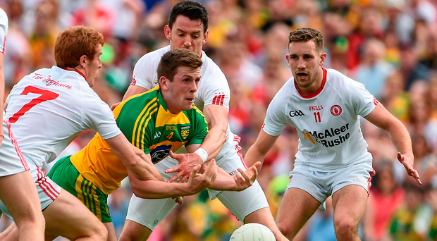 Eoghan Bán Gallagher of Donegal has little time to manoeuvre as Peter Harte (No 7), Mattie Donnelly and Niall Sludden (right) lead the charge for Tyrone Photo: Oliver McVeigh/Sportsfile