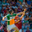 Offaly's Ben Conneely climbs above Galway's Conor Whelan but still loses this aerial battle during yesterday's Leinster SHC semi-final in Portlaoise Photo: Seb Daly/Sportsfile
