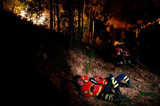 Firefighters rest as they combat a wildfire at Penela, Coimbra, central Portugal Photo: Getty