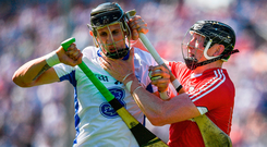 Cork's Damien Cahalane grapples with Waterford's Maurice Shanahan