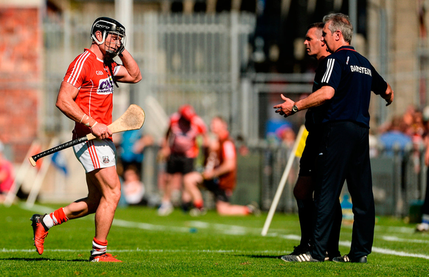 Colm Spillane of Cork leaves the field after being shown the red card by referee Barry Kelly Photo: Piaras Ó Mídheach/Sportsfile