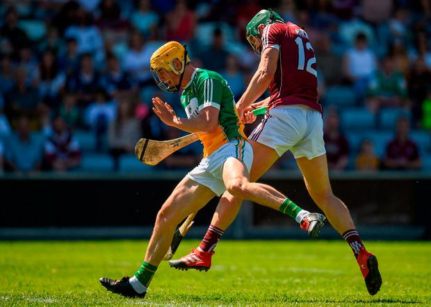 Galway's Niall Burke scores a point while under pressure from Paddy Murphy of Offaly during the Leinster SHC semifinal at O'Moore Park. Photo: Seb Daly/Sportsfile