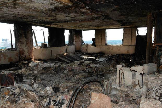 Handout picture released by the Metropolitan Police showing the inside of the Grenfell Tower in London after a fire engulfed the 24-storey building