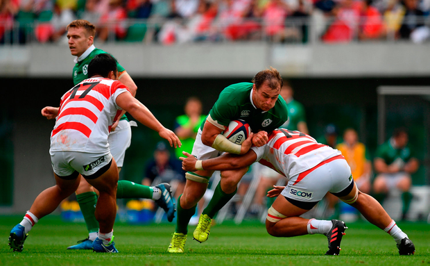Rhys Ruddock of Ireland is tackled by Hendrik Tui of Japan. Photo by Brendan Moran/Sportsfile