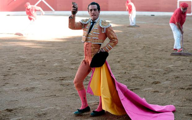 Spanish matador Ivan Fandino holds the ear of a Baltasar Iban bull during a bullfight at Aire sur Adour arena southwestern France, on June 17, 2017. / AFP PHOTO / IROZ GAIZKAIROZ GAIZKA/AFP/Getty Images