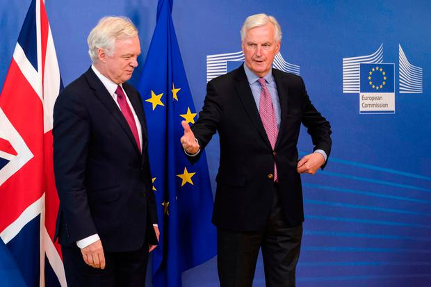 EU Chief Brexit Negotiator Michel Barnier, right, and British Secretary of State David Davis prepare to shake hands as they arrive at EU headquarters in Brussels on Monday, June 19, 2017 (AP Photo/Geert Vanden Wijngaert)